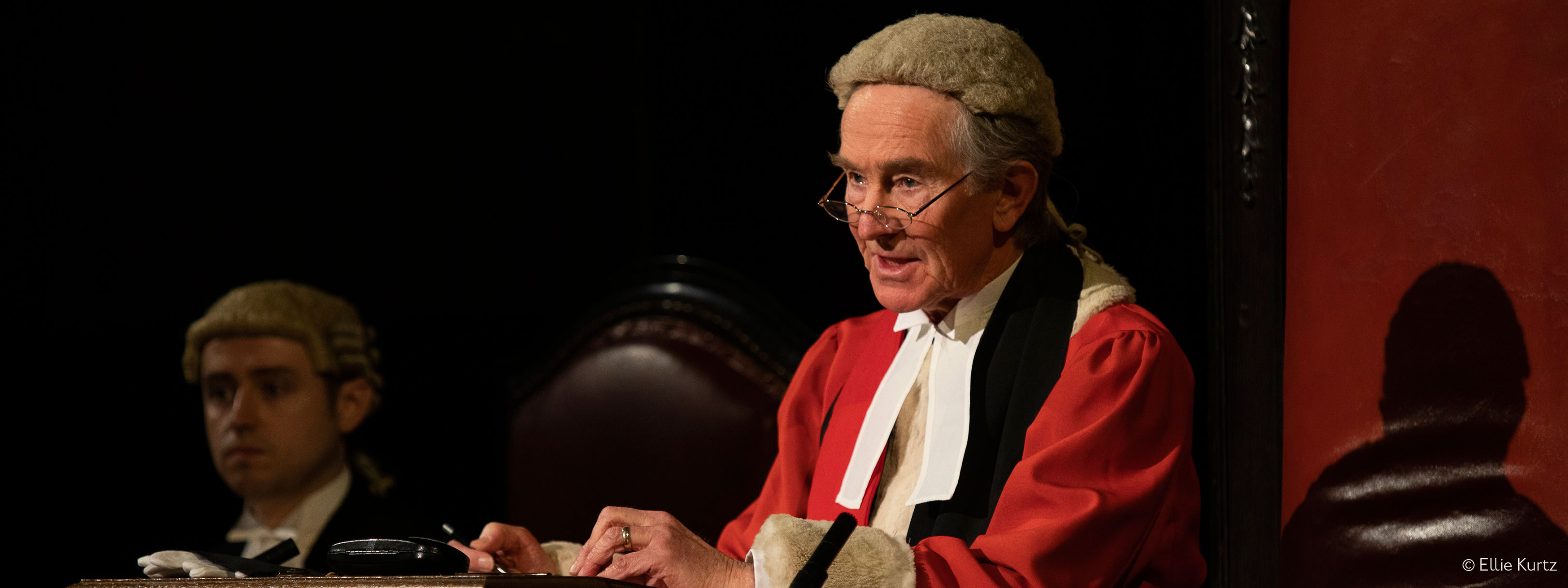 Barister questions a witness in a courtroom theatre show